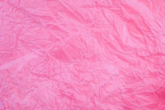 Crumpled vintage red paper textured obsolete background.