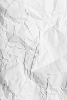 しわくちゃの白い紙の背景のテクスチャ、クローズアップ。