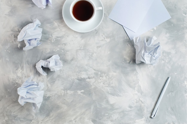 Crumpled white paper on concrete