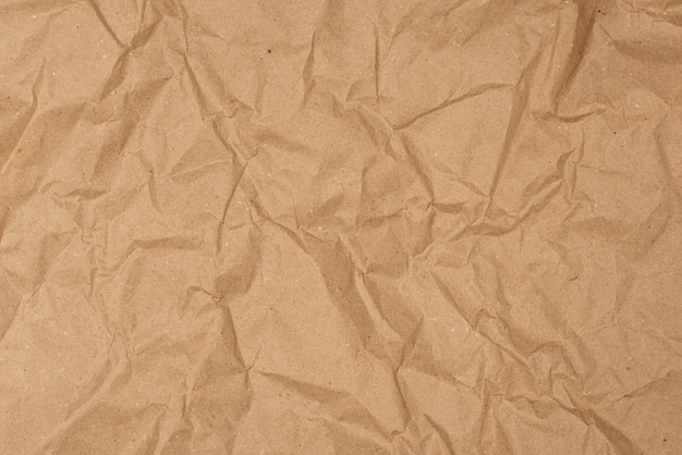 Crumpled wrapping eco paper texture background.