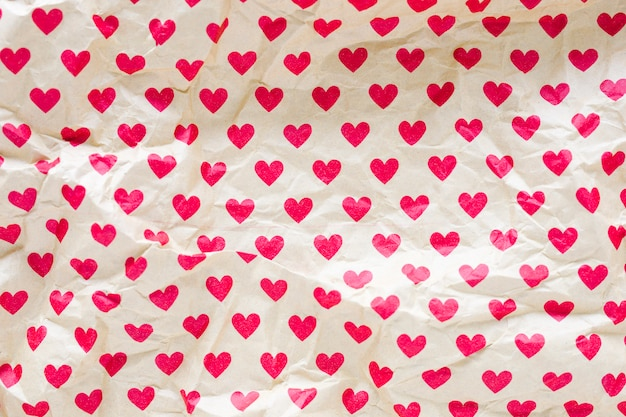 Crumpled wrapping paper with hearts