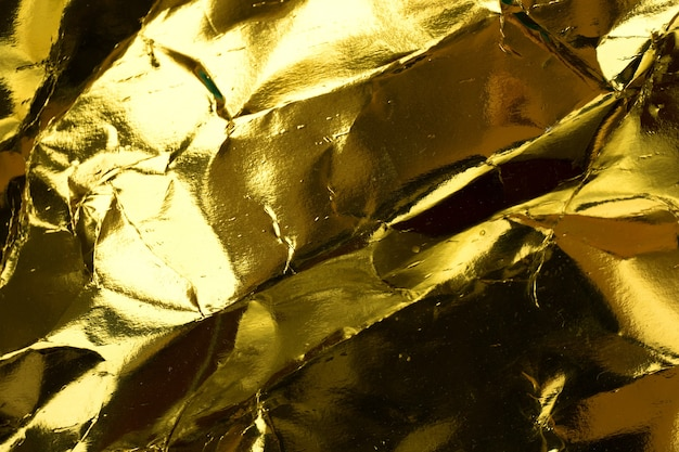 Crumpled yellow gold paper texture