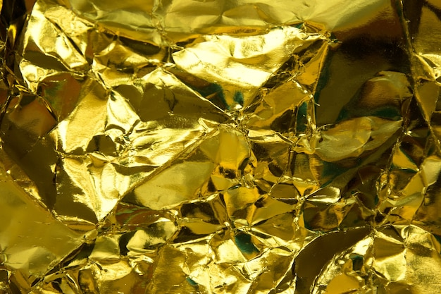 Crumpled yellow gold paper texture.
