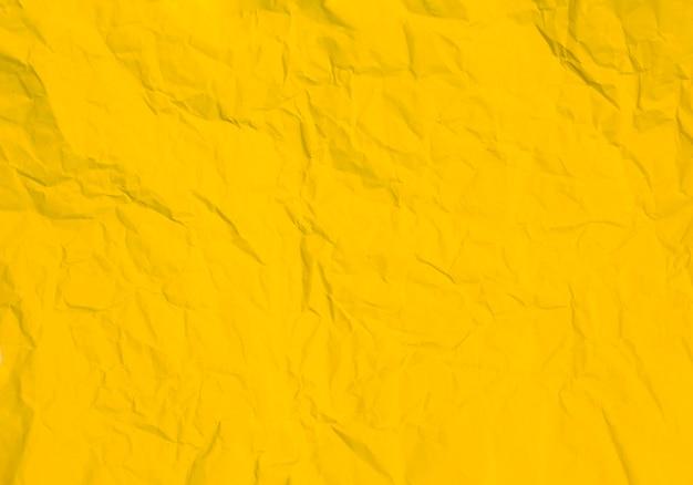 Мятой желтой бумаги фоновой текстуры