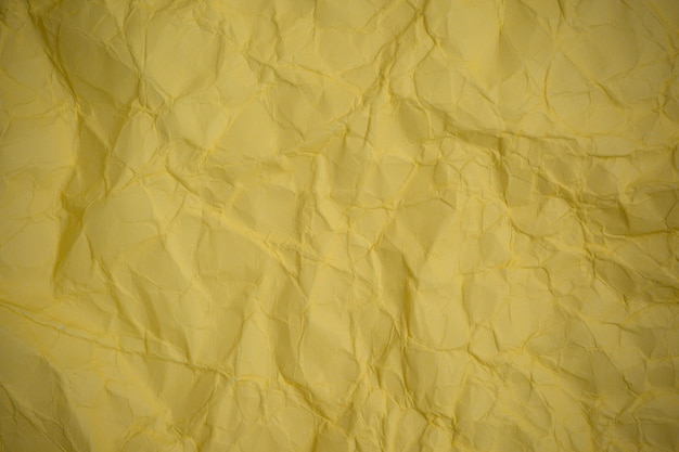 Crumpled yellow paper background