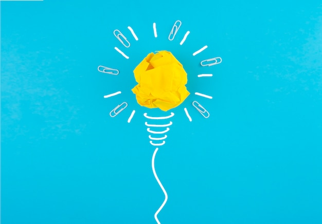 Crumpled yellow paper in a light bulb form