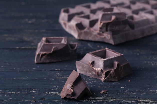 Crunch dark chocolat on rustic table