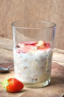 Crunchy musli (whole grain oats) served with fresh strawberries