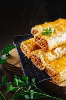 Crunchy phyllo rolls filled with tuna are fresh from the oven