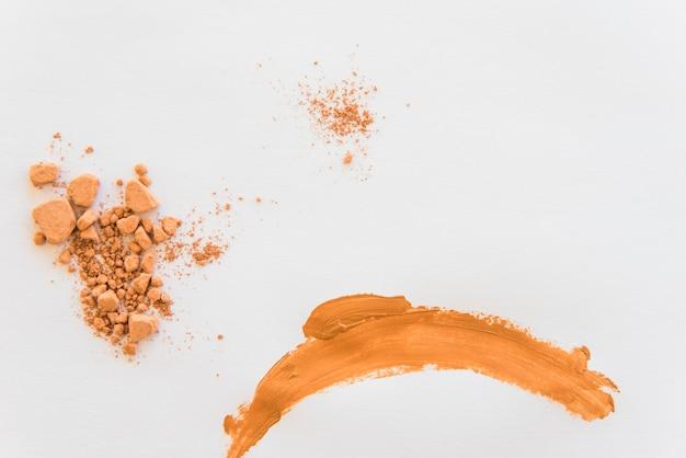Crush compact powder on white background