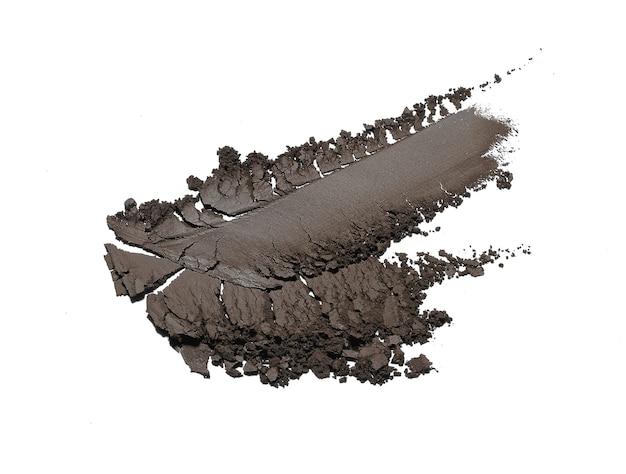 Crushed eyeshadow isolated on white Premium Photo