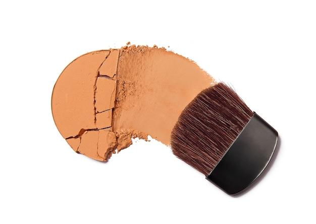 Crushed face powder blush and brush isolated on white