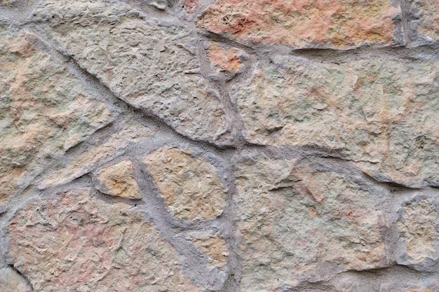 짓 눌린 된 화강암 벽 배경, 질감