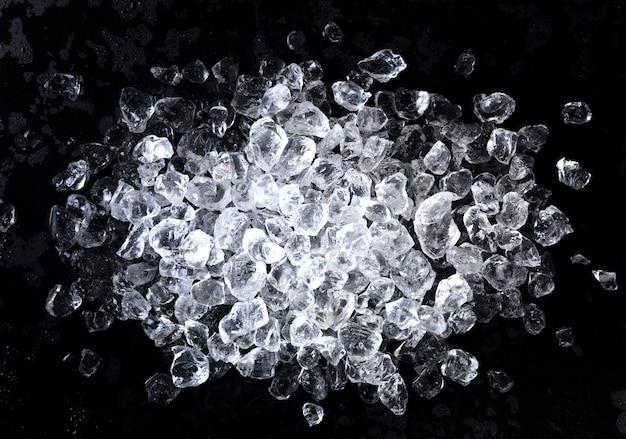 Crushed ice on black background.