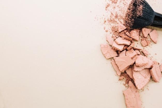 Crushed powder and brush