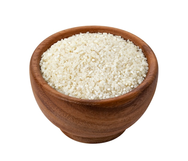 Crushed rice in wooden bowl isolated