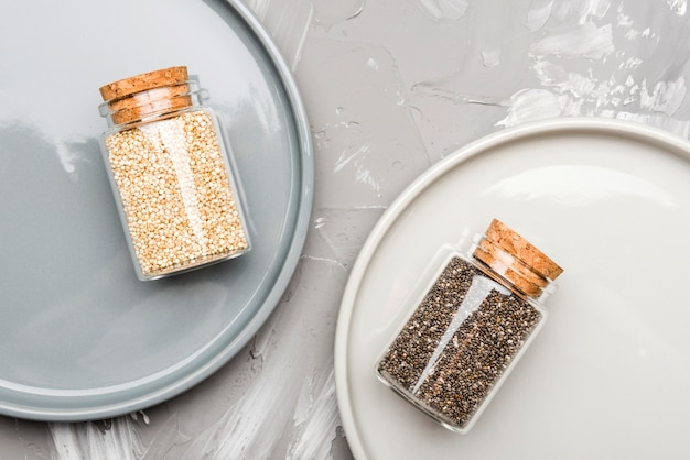 Crushed seeds in tiny glass jars organic food