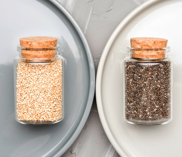 Crushed seeds in tiny glass jars