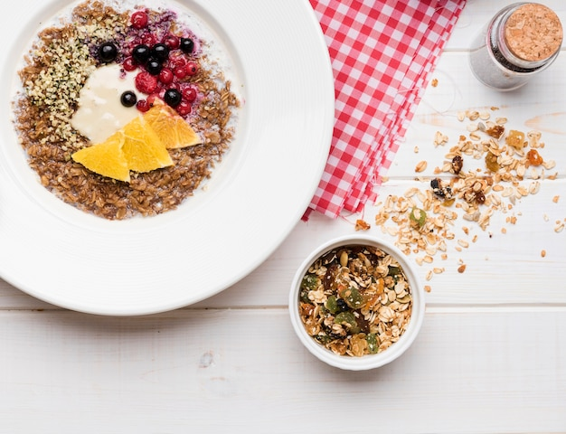 Crushed seeds with slices of orange and fruit cereals