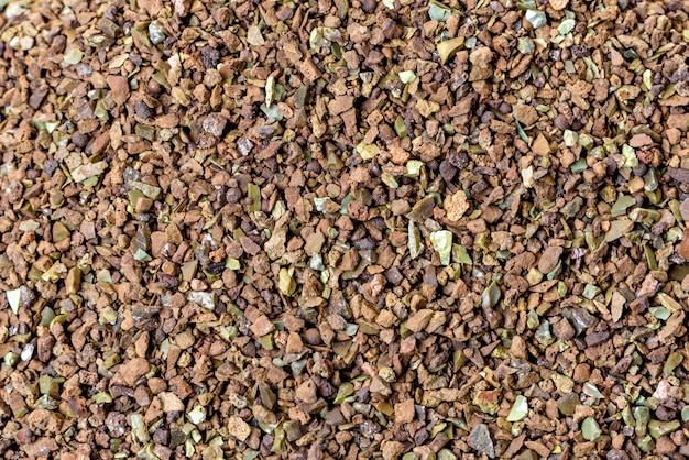 Crushed stone abstract textured background. building material background