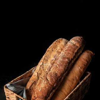 Crusty loaves of bread on black background
