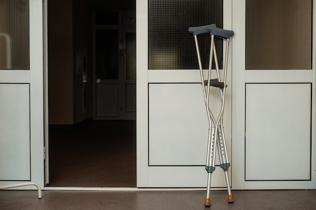 Crutches are near the doors of the hospital