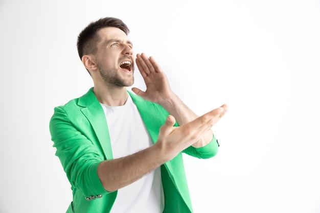 Crying emotional man screaming on studio.