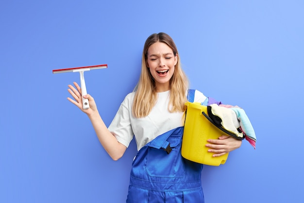 Crying female with cleaning supplies stand screaming