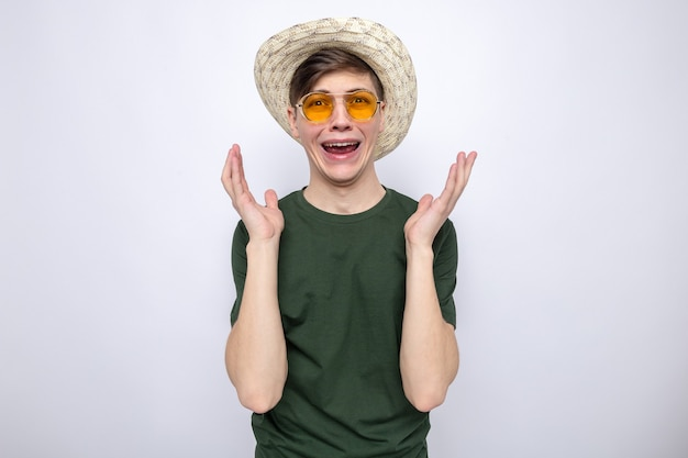Crying holding hands around face young handsome guy wearing hat with glasses