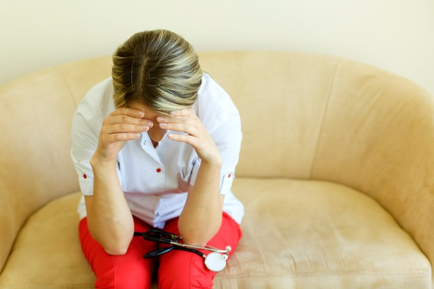 Crying unhappy upset medical nurse. doctor sad and depressed having stress breakdown.