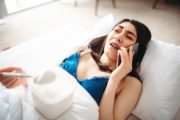 Crying woman talking by phone, female depression