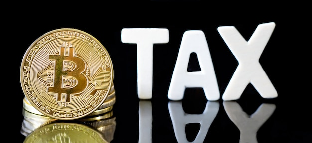 Crypto currency  bitcoin coin with tax message ,concept determining the tax law of digital money.