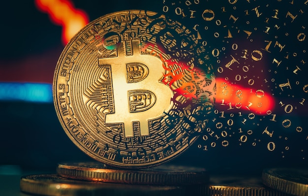 Crypto currency golden coin. gold bitcoin falling apart. concept of a cryptocurrency market crisis and defocused chart background.