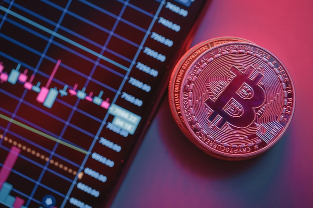 Cryptocurrency chart and bitcoin. close-up photo. the rise and fall of the internet currency in the