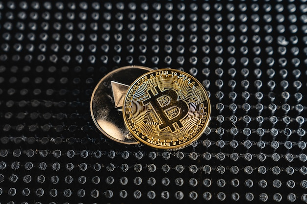 Cryptocurrency coin on dark table