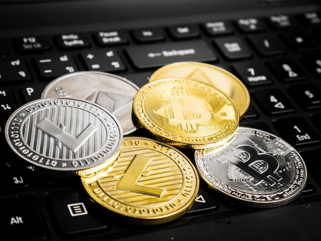 Cryptocurrency coins on the black keyboard.