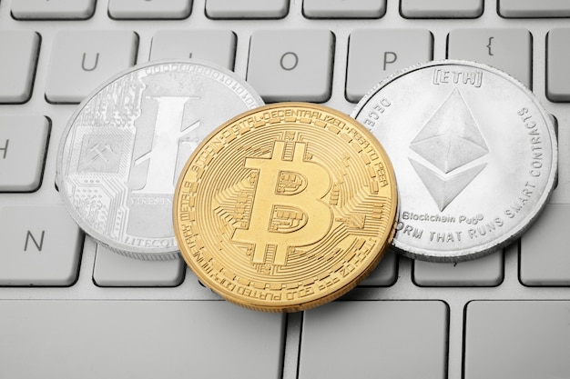 Cryptocurrency coins on keyboard