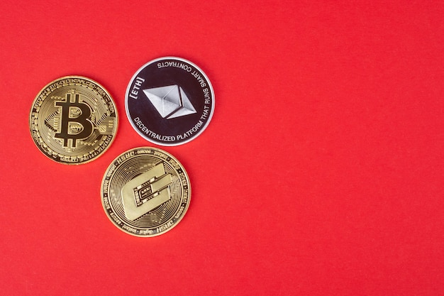 Cryptocurrency coins on a red background  bitcoin ethereum dash
