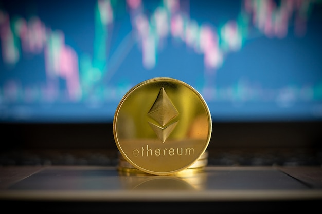 Cryptocurrency ethereum coin and financial chart in background