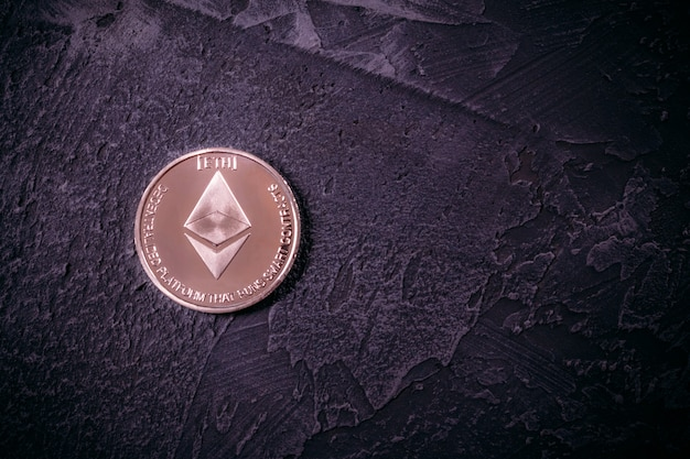 Cryptocurrency ethereum on the concrete surface