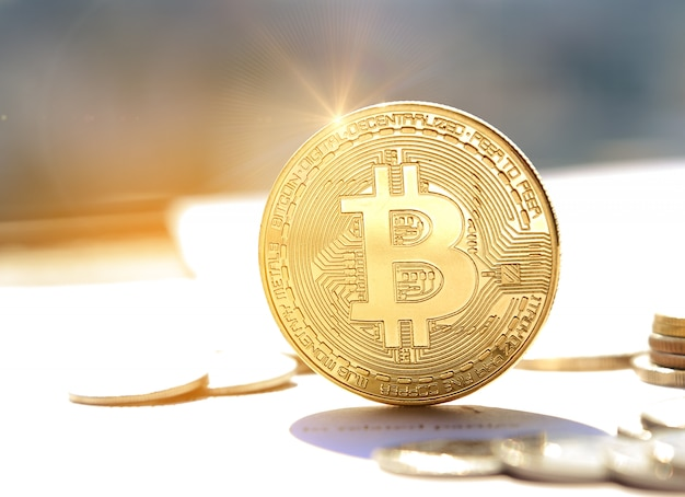 Cryptocurrency physical bitcoin in sunset time