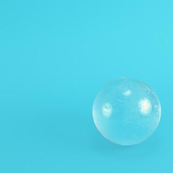 パステルカラーの明るい青色の背景に水晶玉