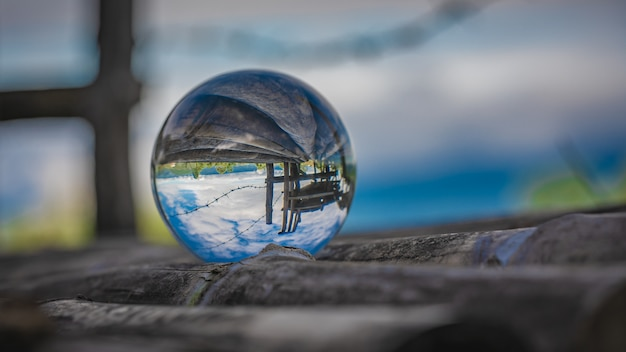 Crystal ball with green field