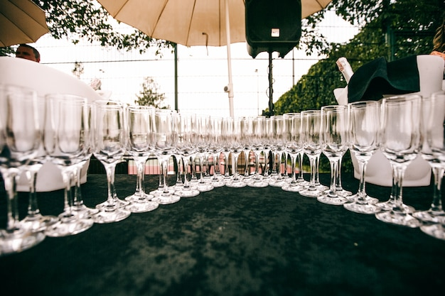 Crystal champagne flutes stand on a table