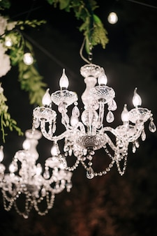 Crystal clear chandeliers with candlesticks and candelabra candle light bulbs glass pendants and