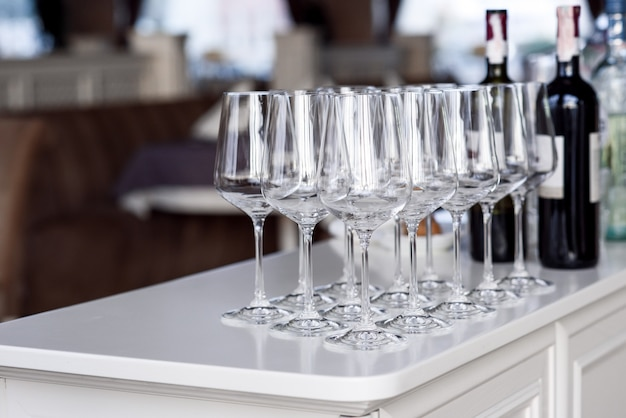 Crystal clear empty wine glasses on a table.