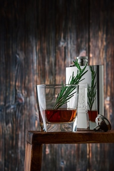 Crystal glass and bottle with whiskey