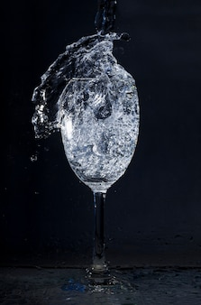 Crystal glass with water in motion