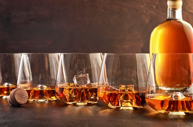 Crystal glass with whiskey on a wooden table