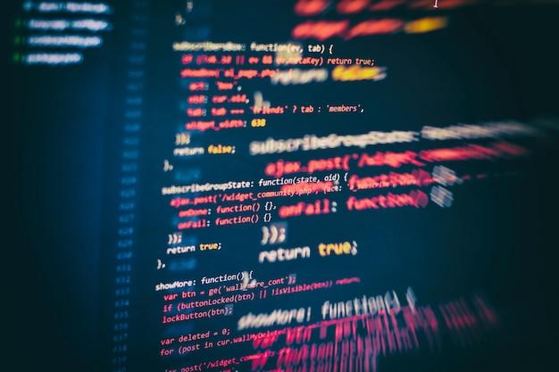Css、javascript、およびhtmlの使用法。関数のソースコードのクローズアップを監視します。抽象的なit技術の背景。ソフトウェアのソースコード。